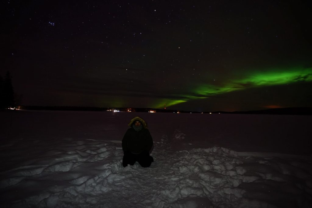 guest with aurora on the background