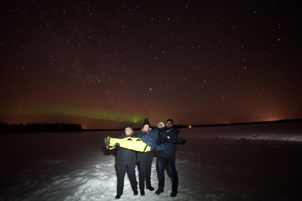 friends with northern lights on background